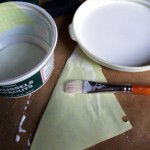 Apply a thin layer of glue to the paper and apply to bowl then spread a layer on top.