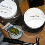 Gather Supplies: charcoal/stones, potting soil, seeds, hammer, nail, empty can