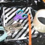 Gather: plastic bag, pipe cleaners, string, tape, scissors, hole puncher.