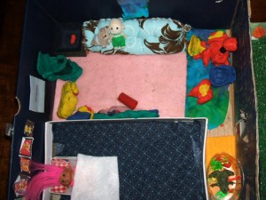 An aerial view of the multi-purpose room which features a hand-sewn couch, aquarium, sleeping area & games!