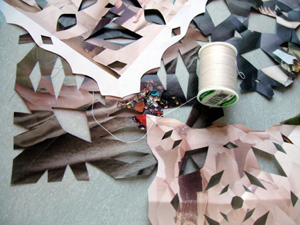 cut snowflakes from recycled paper