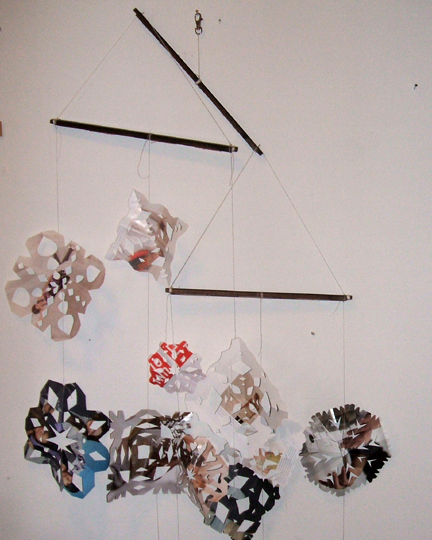 string recycled snowflakes together