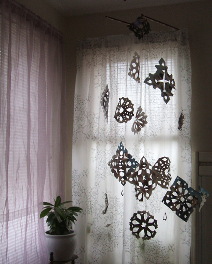 recycled magazine snowflake mobile