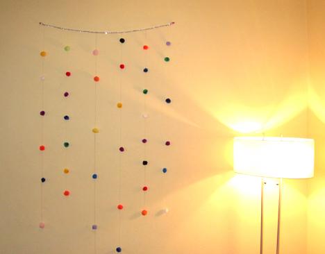 pom-pom wall hanging
