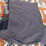 Lay the t-shirt upside down on a flat surface.
