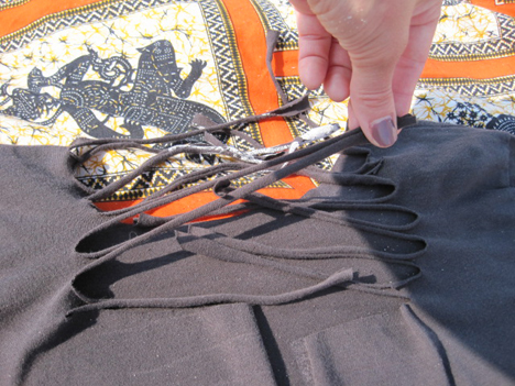 Gently tug each cut strand to stretch and curl the fabric.