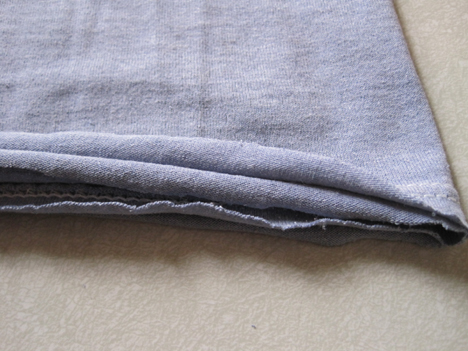 Gently tug the bottom hem to curl. Done.