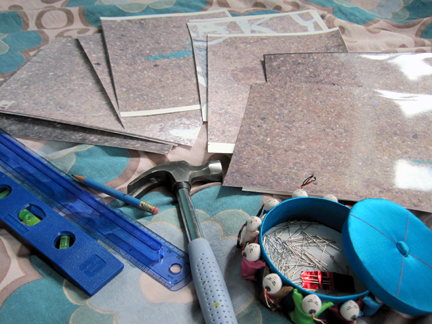 Gather supplies: pins, small hammer, level, ruler, rasterbated images.