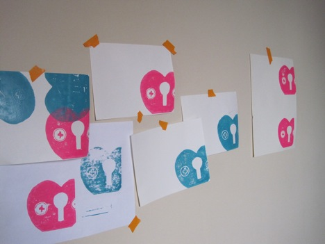 Slowly peel the paper away from the block, hang, or lay flat to dry. Shown is as assortment of test prints and final pieces.